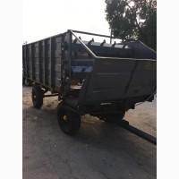 Тракторный универсальный кормораздатчик КТУ-10А