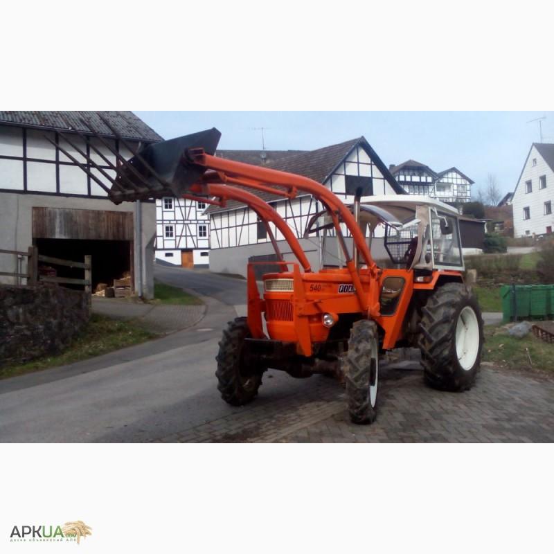 трактор с фронтальным погрузчиком фото